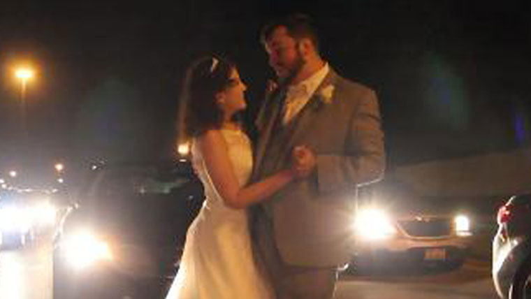 Couple-caught-up-in-traffic-has-their-first-dance-on-highway